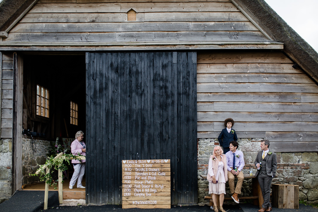 wedding guests relaxing outside bowerchalke barn near salisbury