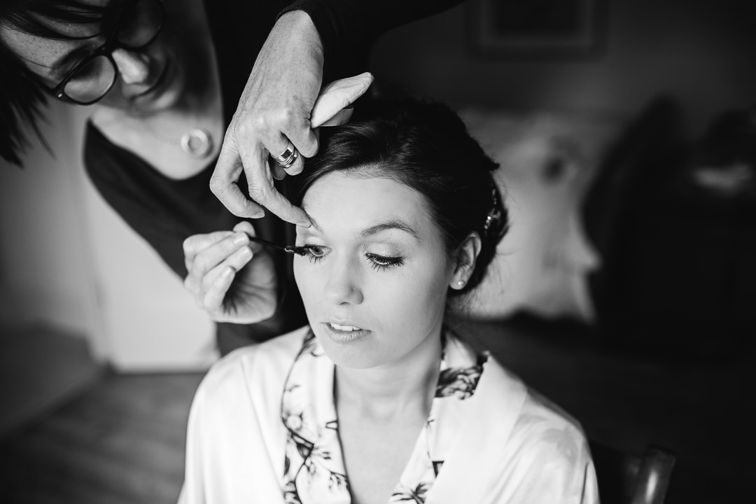bride having make up applied by Victoria Fergusson photo by Lydia Stamps Photography