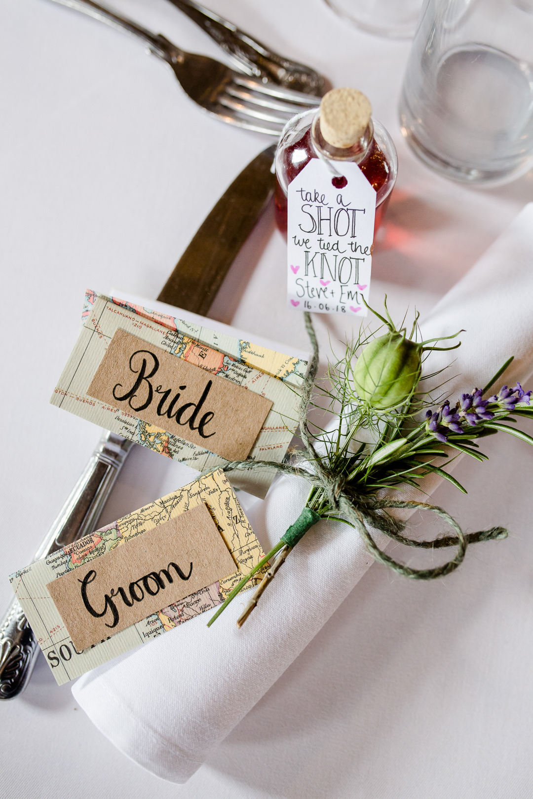 map themed place names and shot wedding favours
