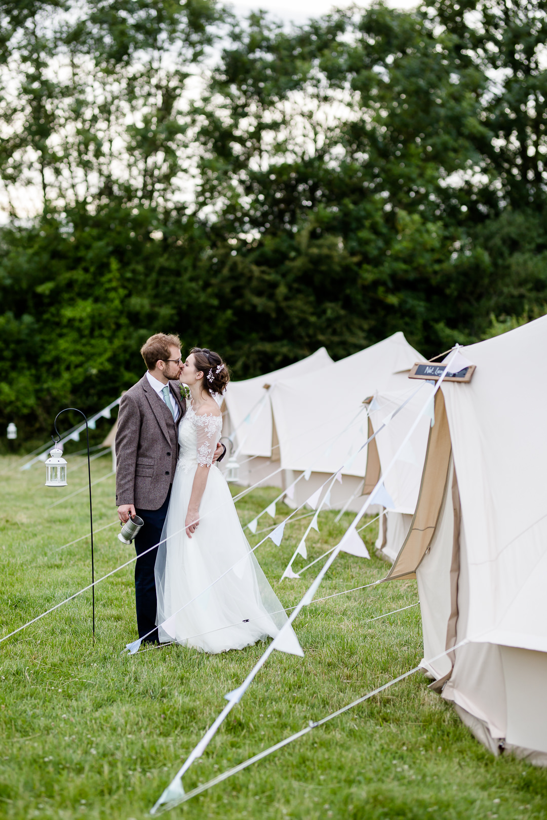 bride and groom in glamping village