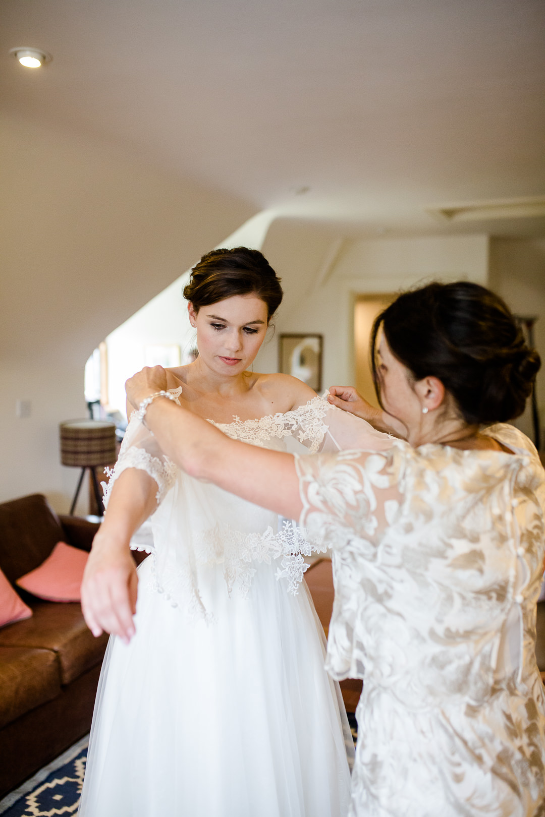 bride getting dressed for wedding in Salisbury photo by Lydia Stamps Photography