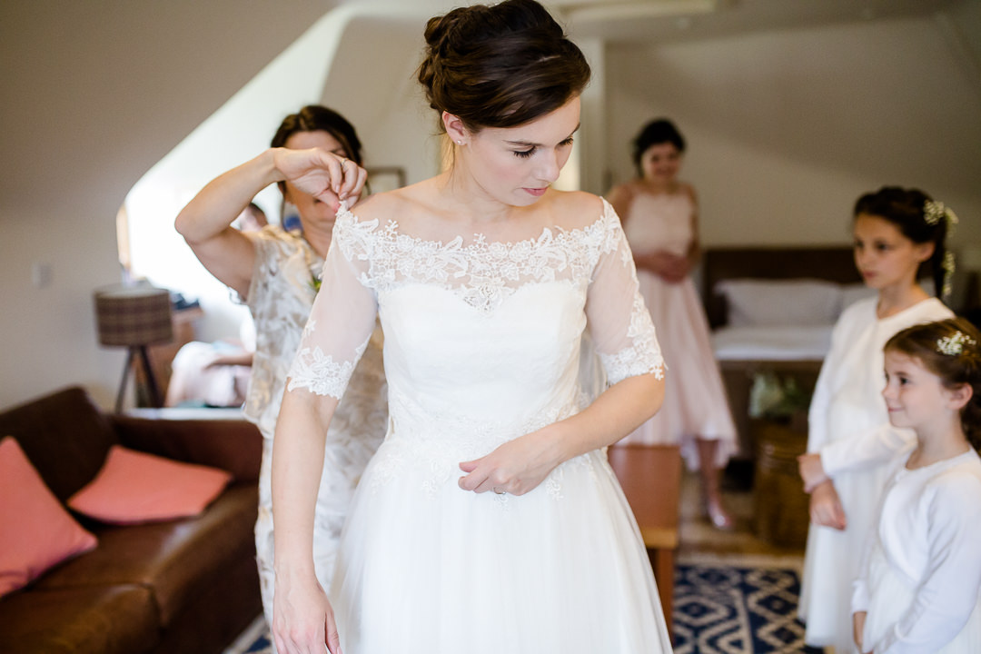 bride getting ready for wedding photo by Lydia Stamps Photography