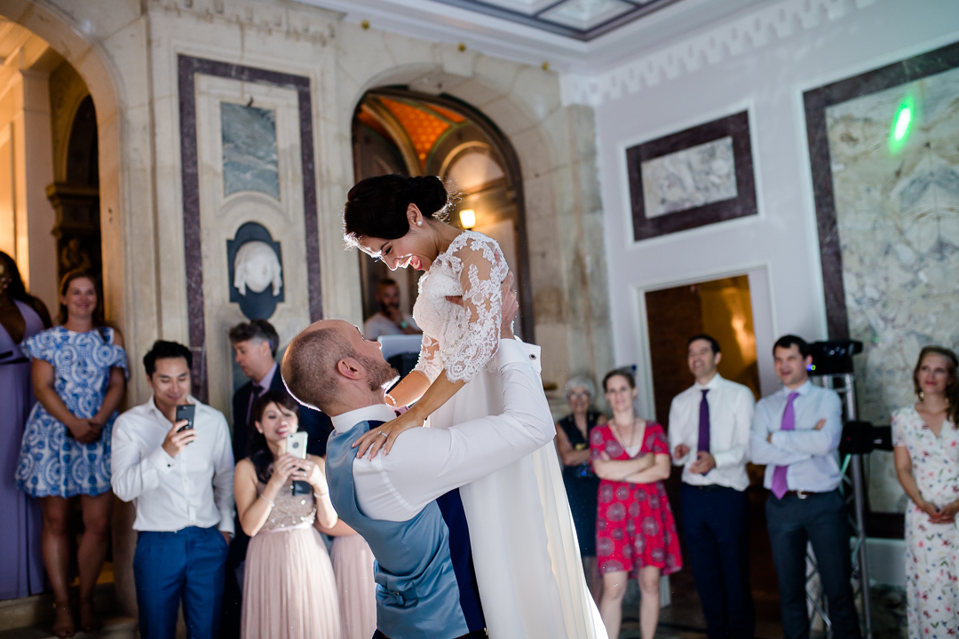 groom lifts bride during their first dance at their chateau bouffemont destination wedding in france image