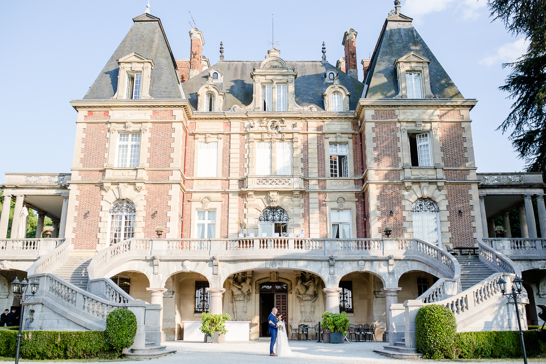 bride and groom embrace outside chateau bouffemont paris france image