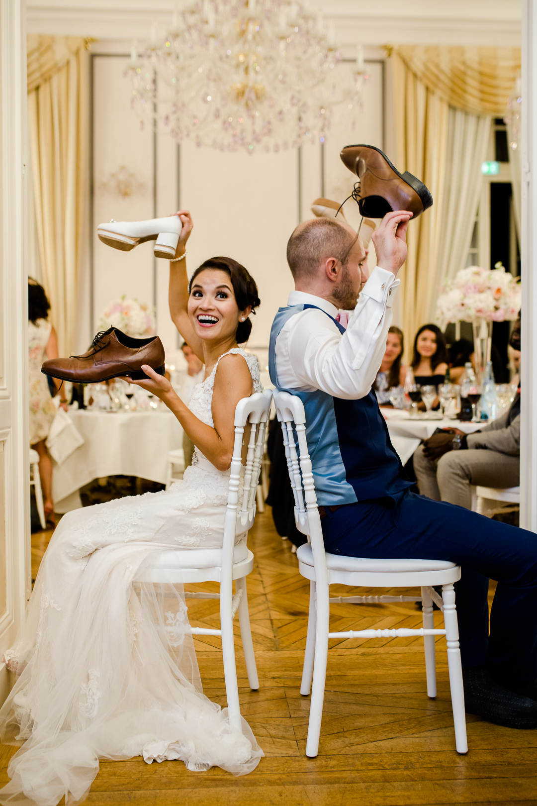 bride and groom playing the shoe game in the salon at chateau bouffemont france image