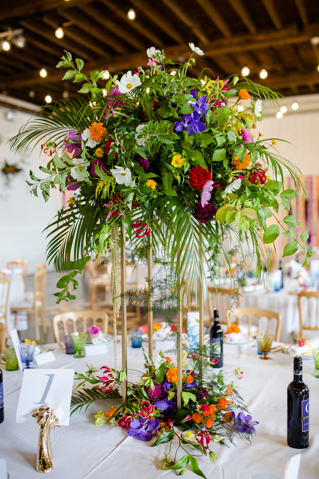 Colourful and tropical wedding flower centrepiece by Rust & Bloom at Trinity Bouy Wharf London