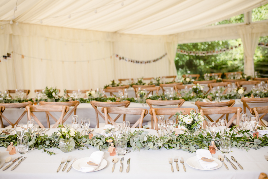 wedding tablescape with greenery garlands and bentwood chairs
