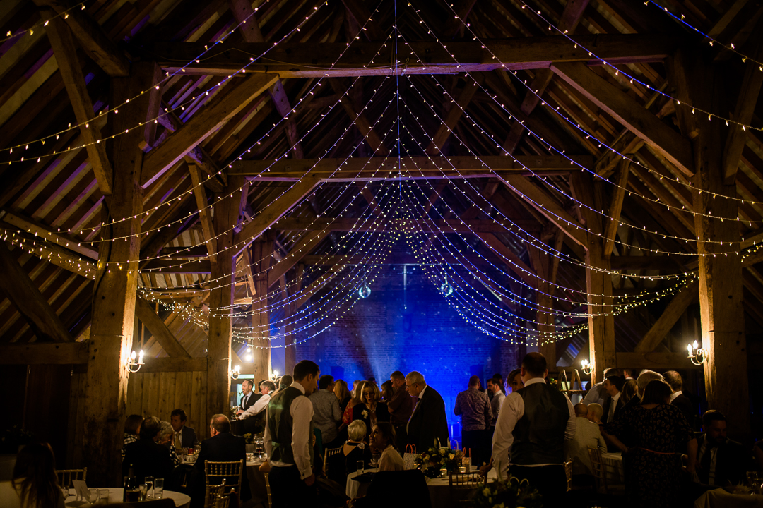Barford Park Barn wedding venue near Salisbury lit with fairy lights photo by Lydia Stamps Photography