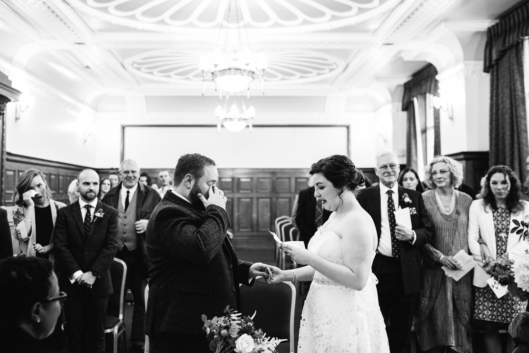 groom sheds a tear during a wedding ceremony at Islington Town Hall, London