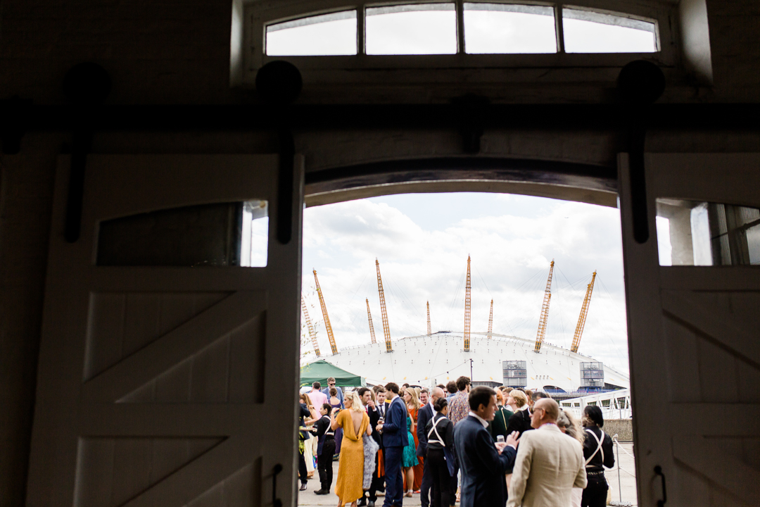 wedding drinks reception with the millenium dome in the back ground at Trinity Bouy Wharf London