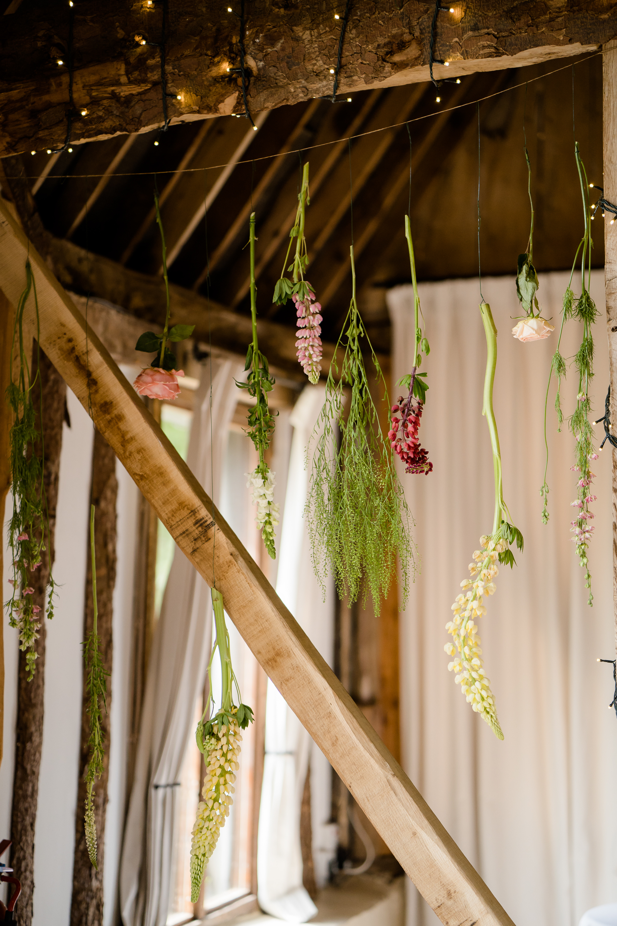 Hanging flower wedding decor by The White Horse Flower Company Newbury