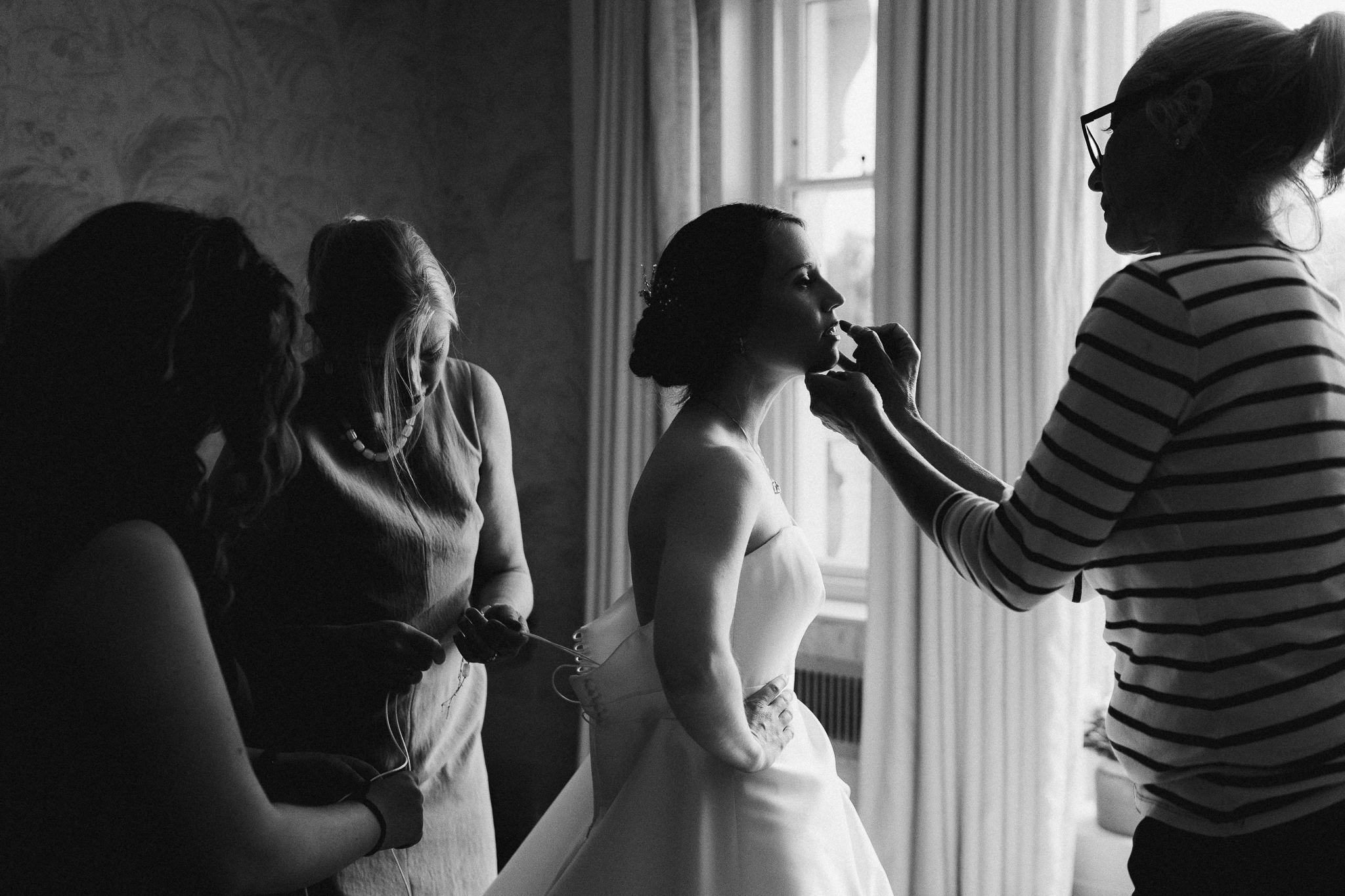 bride having make up done at coworth park hotel photo by Lydia Stamps Photography