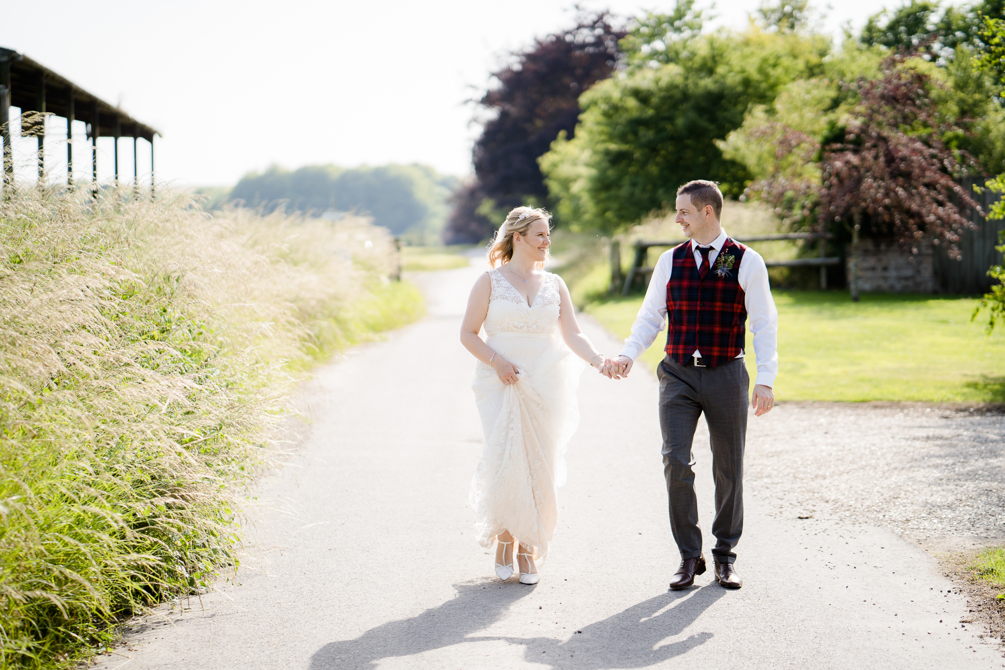 Bride and Groom taking a walk at Casterley Barn photo by Lydia Stamps Photography
