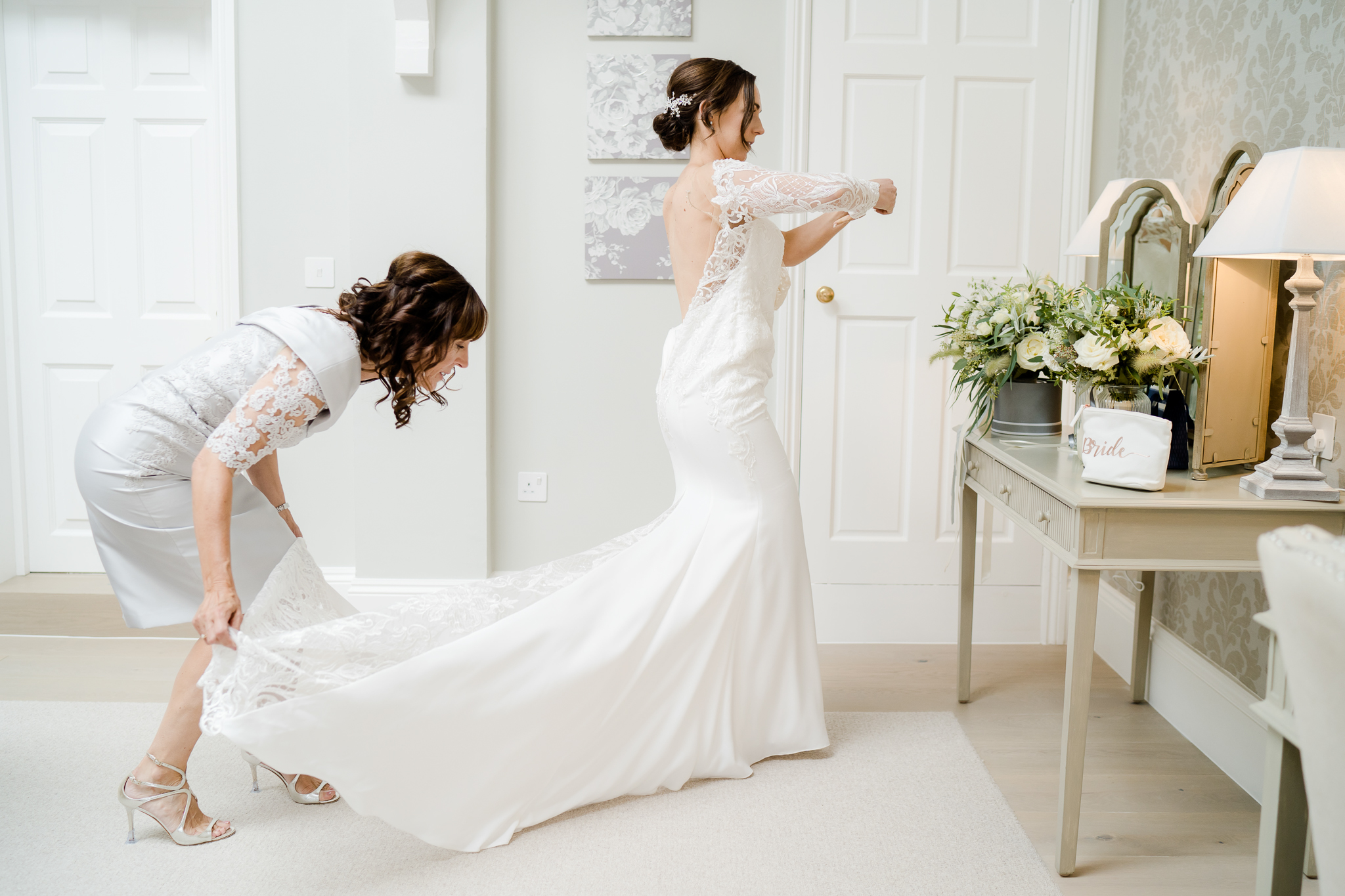 bride getting dressed in the bridal prep suite at Syrencot
