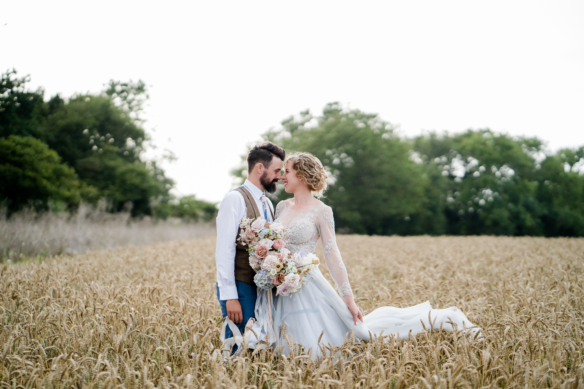 bride and groom photos in a cornfield