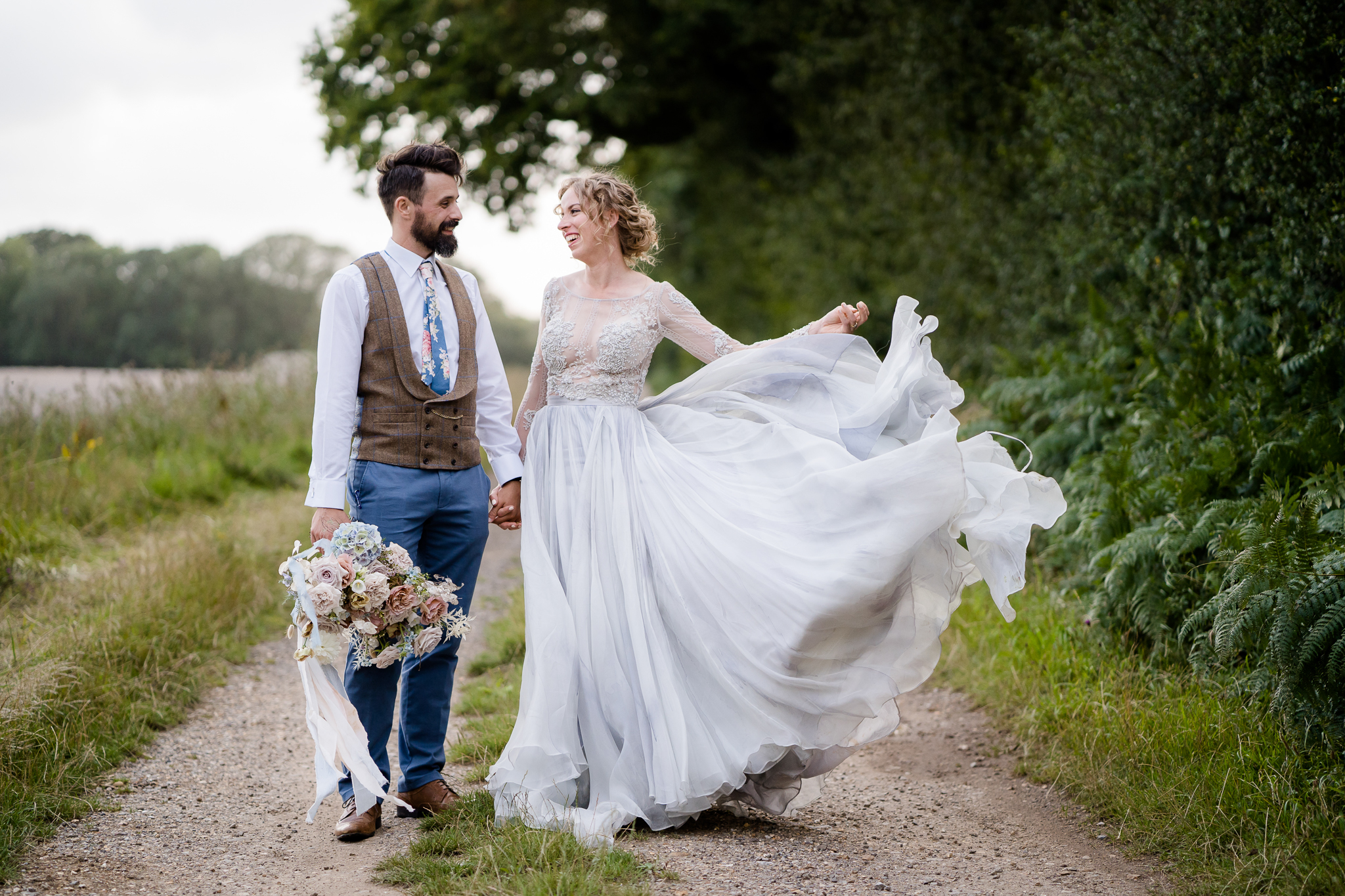 bride wearing a blue wedding dress by Leanne Marshall