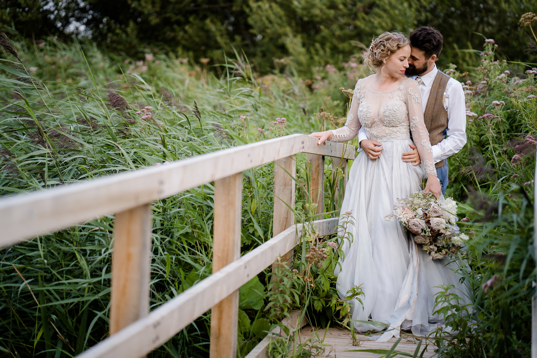 wedding photos at the barn at avington bride and groom on a bridge