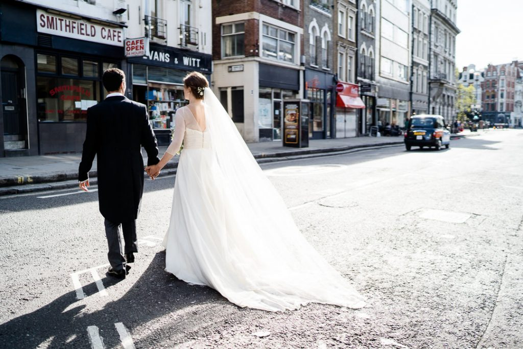 bride and groom walking through the streets of London photo by Lydia Stamps Photography