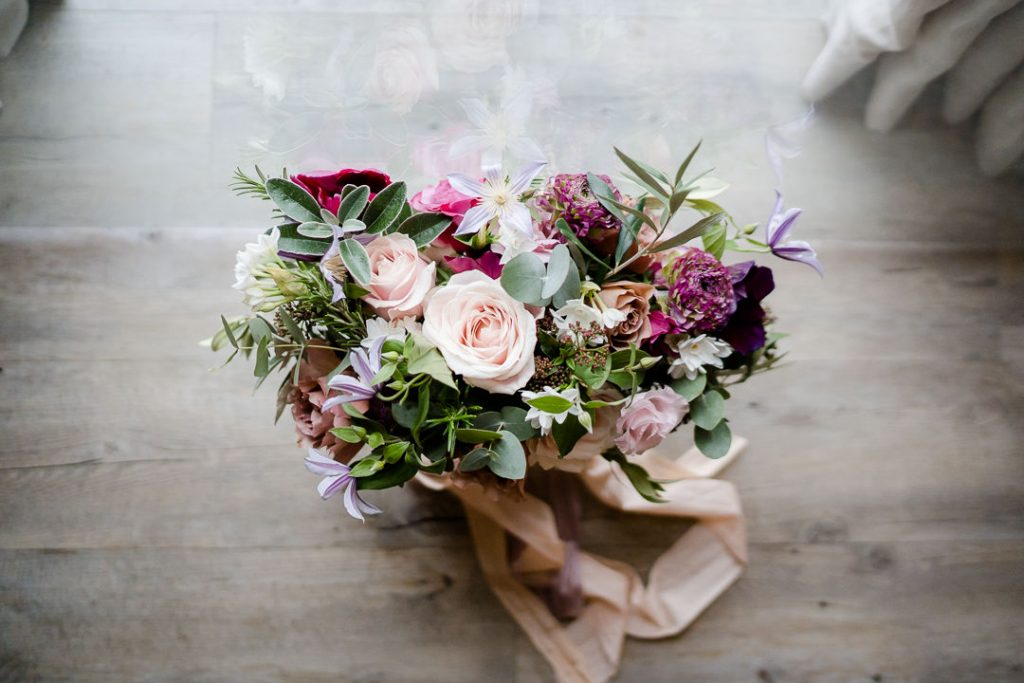winter wedding bouquet by Eden Blooms with pink roses and anenomesphoto by Lydia Stamps Photography