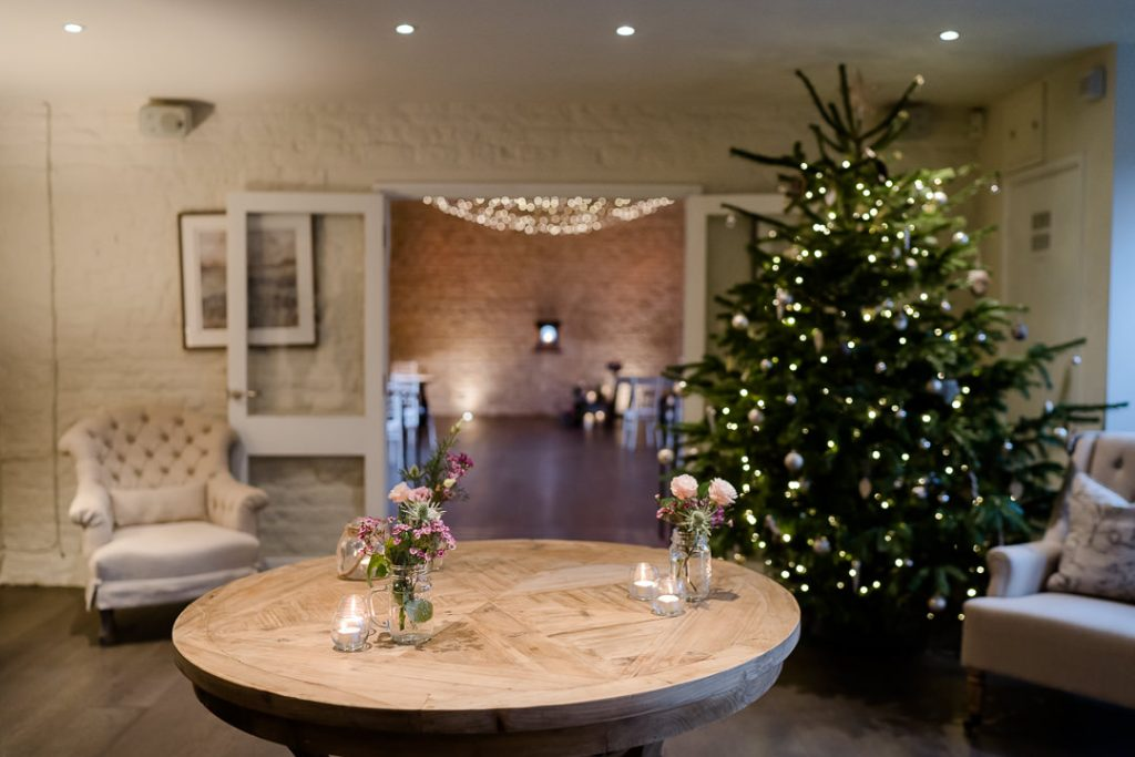 inside Lapstone Barn wedding venue in the Cotswolds, dressed for a Christmas wedding photo by Lydia Stamps Photography