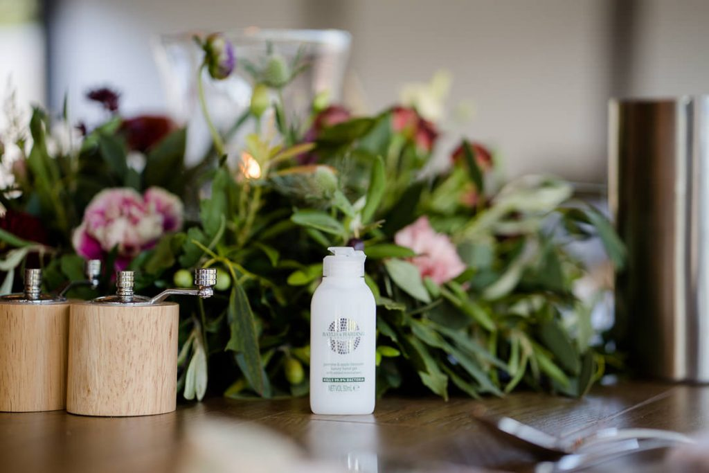 hand sanitiser as part of a wedding table scape for a lockdown micro wedding at Syrencot photo by Lydia Stamps Photography
