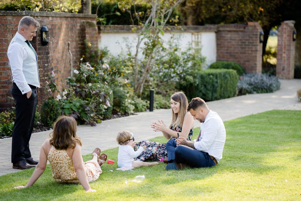 relaxed photo of guests sitting on the lawn at Syrencot photo by Lydia Stamps Photography
