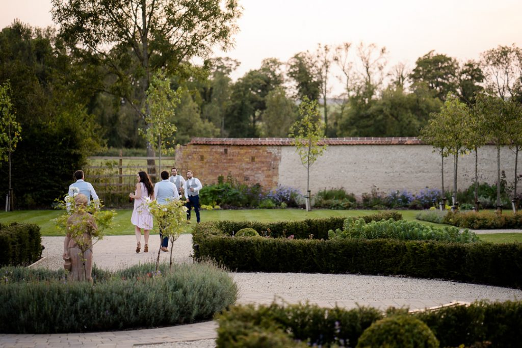 guests in the gardens at Syrencot as the sun sets photo by Lydia Stamps Photography
