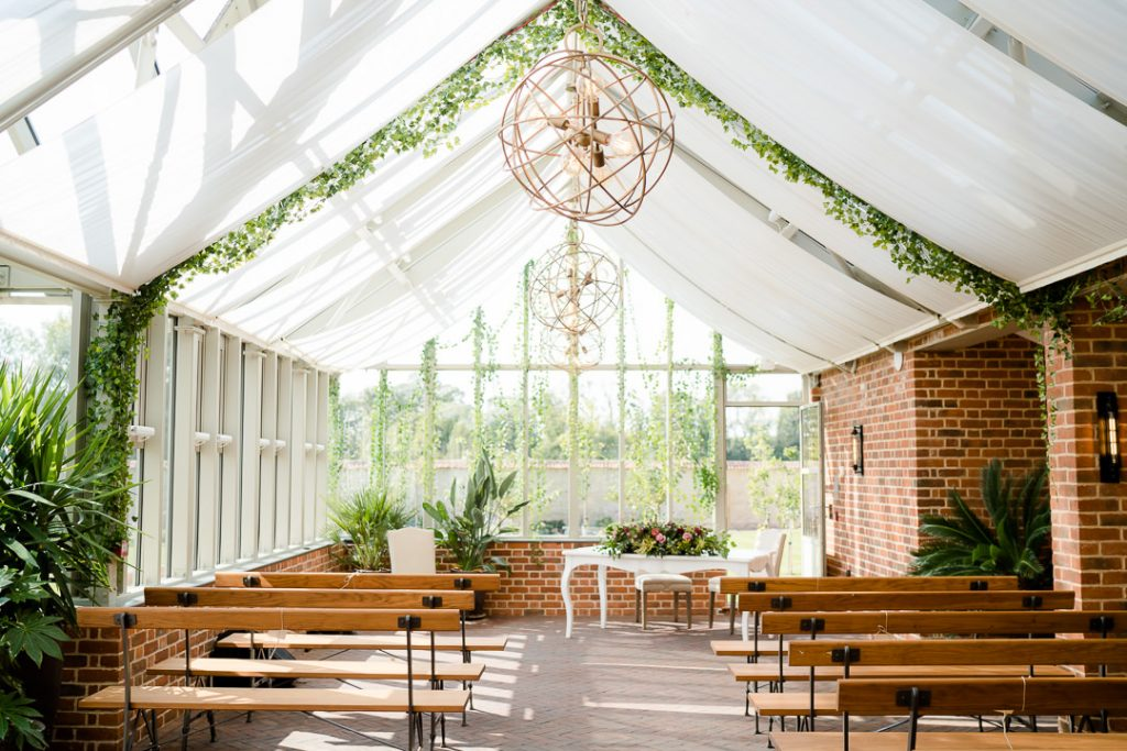 inside the glass house orangery ceremony area at Syrencot Photo by Lydia Stamps Photography