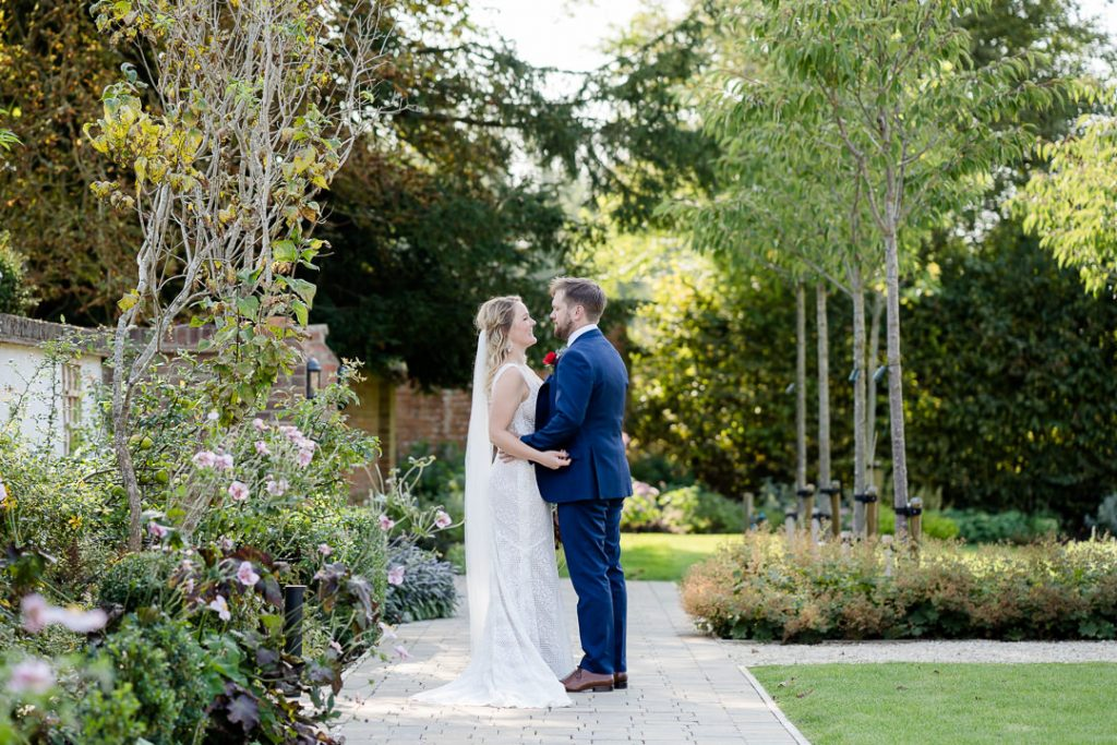 bride and groom stood in the walled garden at Syrencot photo by Lydia Stamps Photography