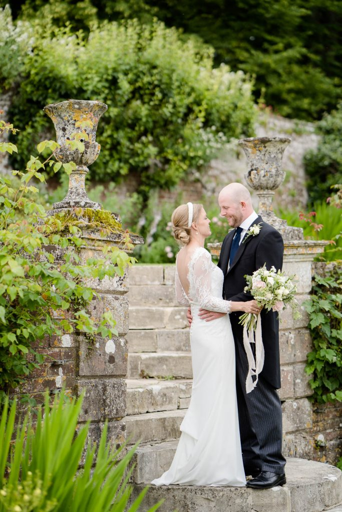 bride and groom in the sunken garden at Hatch House wedding venue in Wiltshire photo by Lydia Stamps Photography