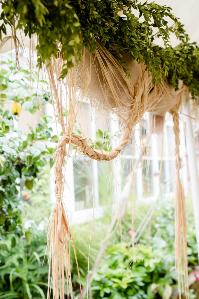 rustic straw marquee decor at a Pythouse Kitchen Garden Wedding near Salisbury Wiltshire photo by Lydia Stamps Photography
