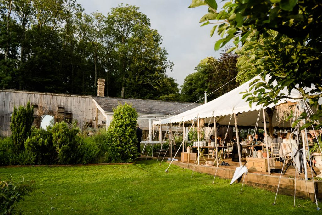 marquee outside Pythouse Kitchen Garden in Wiltshire photo by Lydia Stamps Photography