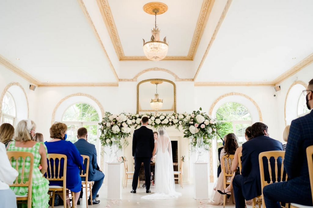 wedding ceremony in The Vine Room at Northbrook Park Hampshire photo by Lydia Stamps Photography