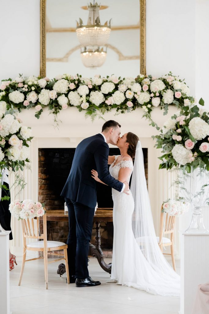 bride and groom share their first kiss as husband and wife in the vine room at Northbrook Park photo by Lydia Stamps Photography