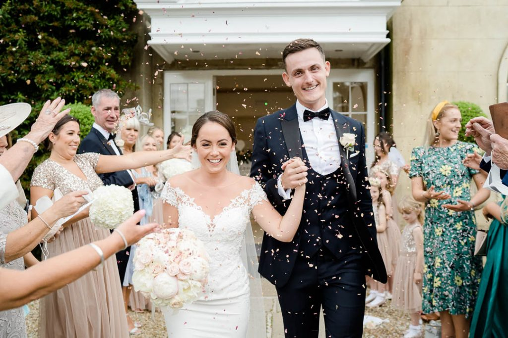 bride and groom outside Northbrook Park on their wedding day photo by Lydia Stamps Photography
