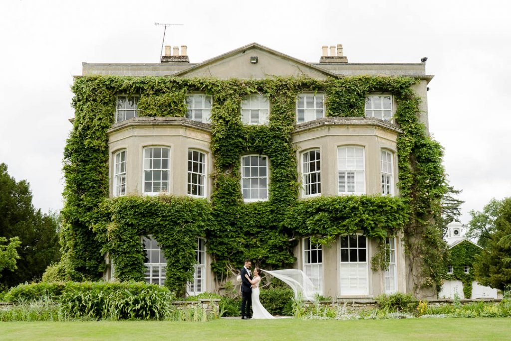 bride and groom outside Northbrook Park wedding venue Hampshire photo by Lydia Stamps Photography