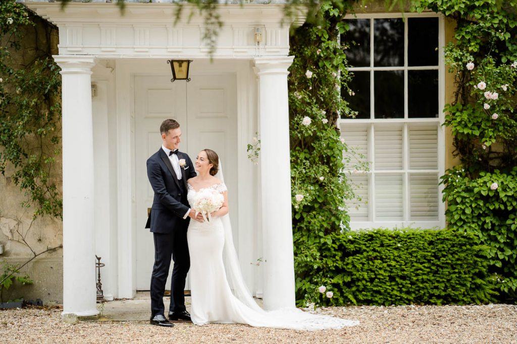 bride and groom outside the doors of Northbrook Park on their wedding day photo by Lydia Stamps Photography