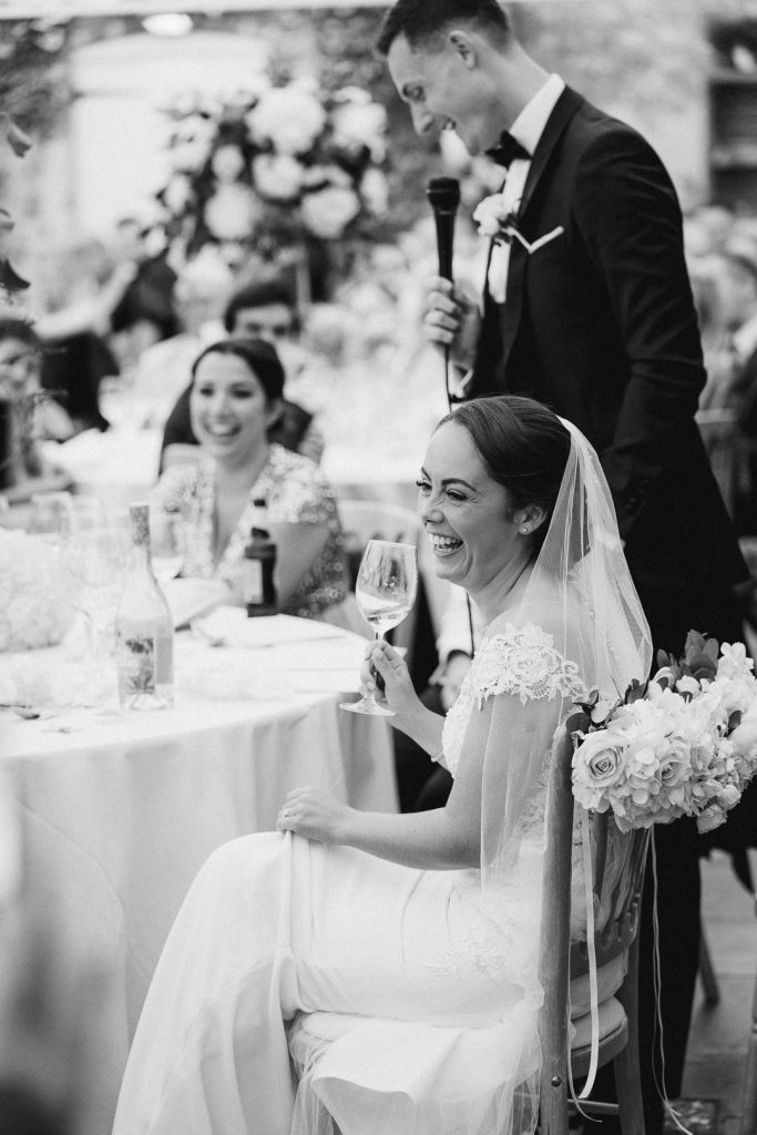 wedding speeches in the orangery at Northbrook Park photo by Lydia Stamps Photography