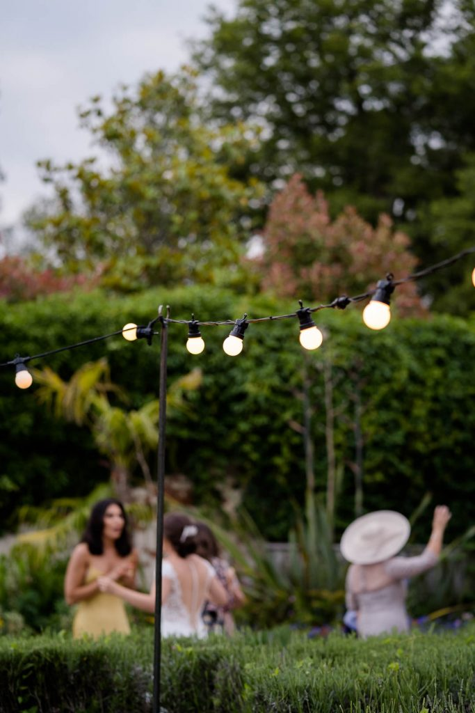 festoon lights in the courtyard at Northbrook Park photo by Lydia Stamps Photography