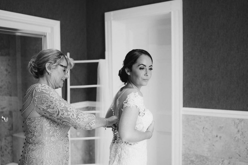 bride gets dressed in the bathroom at Northbrook Park photo by Lydia Stamps Photography